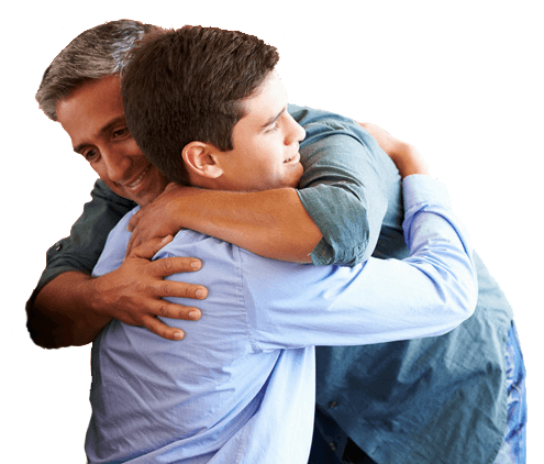 Man supporting teen with hug