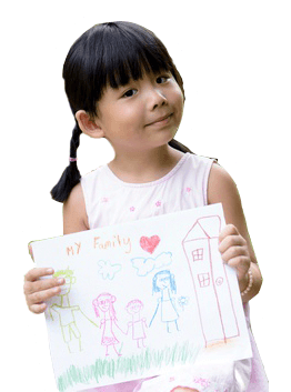 child holding up drawing of family